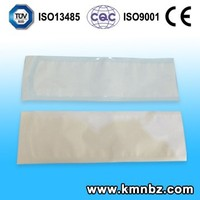 Surgical heat sealing sterilization pouch for gauze