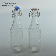 Embossed glass milk bottle with metal clips and ceramic lid 530ml