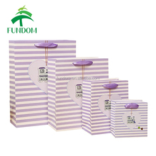 China alibaba 2017 hot sale ODM design printed fashion beautiful purple strip foldable luxury paper large shopping bag
