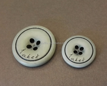 Dyed light blue bone button with engraved logo
