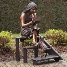 fine cast bronze sculpture girl sitting on steps reading and dog