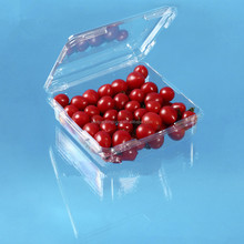 Plastic clamshell fruit packing box with clear hinged lid