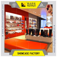 Attractive fashion boots shoes shop interior design with wood wall cabinet and display table