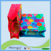 New designed hot handmade fancy paper carrier gift bag supplier and manufacture in china