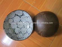 Hard bowl made from coconut shell, with details combination seashell and eggshell inside bowl