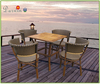 teak wood outdoor table and wicker chairs
