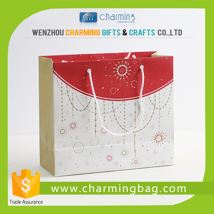 2015 New fancy custome logo printed shopping gift paper bag