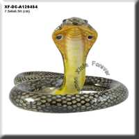 pretty ceramic snake figurine