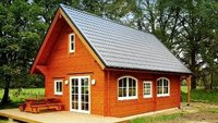 Trebbe wooden log house