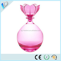 oval clear perfume glass bottle with flower perfume cap stopper