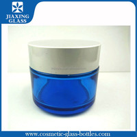 Quality Assured 100g Blue Empty Glass Cosmetic Jar with Sliver Lid