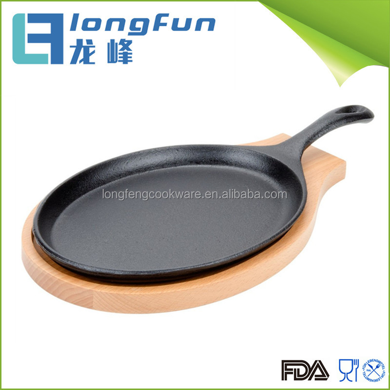 Cast iron hot sizzle sizzling sizzler steak plate with wooden base