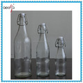 Food grade drinking swing top glass water bottle with stoppers