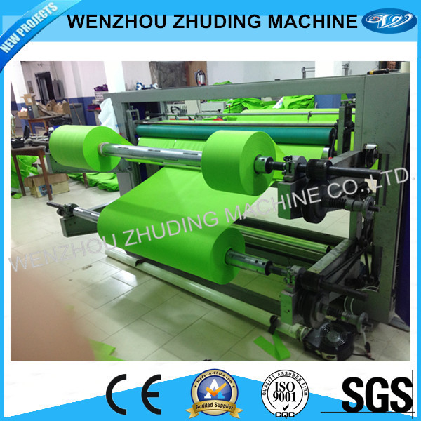 Cuting and rewinding machine for film