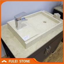 Sunny beige marble one piece bathroom sink and countertop