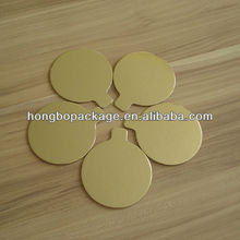 roud gold laminated mini cake board with small tab
