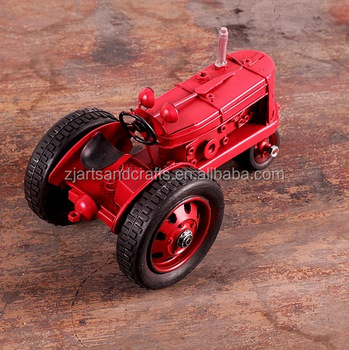 Vintage red metal tractor model for cafe bar decorations