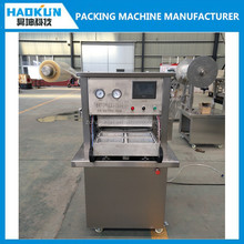 new condition heat sealing tray MAP vacuum filling packaging machine for cooked meat and poultry