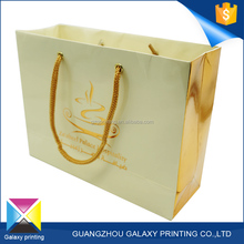 Most popular embossed gloss varnishing hand gift luxury paper shopping bag