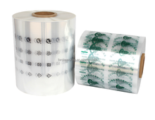 Printed polyolefin shrinkable film rolls for high speed automatic wrapping machines