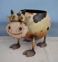 Small metal flower pot with cow shape
