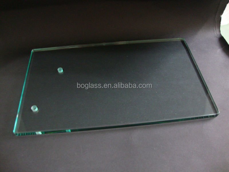 High clear heat resistant glass sheet for microwave oven