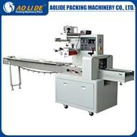 Automatic plastic container filling and sealing pillow packing machine