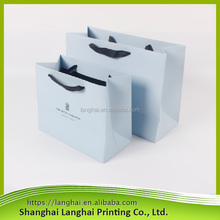 Low price glossy laminated handling paper shopping bag with logo print