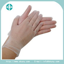 Size L lightly powdered disposable vinyl exam gloves