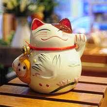 Japanese Lucky Cat Cat and wind piggy bank ceramic cat ornaments Sakura opened Jushi A0302