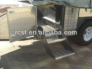 Large soft floor camper trailer with step through