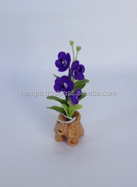 Miniature Thai clay flower, orchid design with elephant ceramoc base