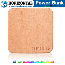 Newest products shell customized design logo 4000mah portable wooden power bank
