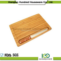 wooden bread board cutting board with knife