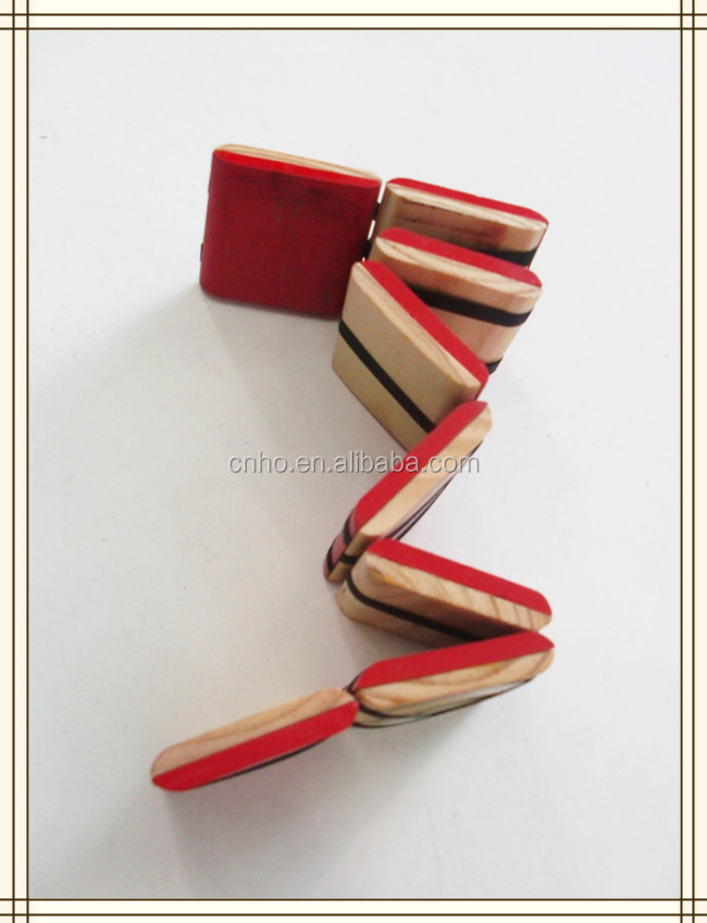 Wooden toy with ribbon