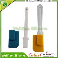 Silicone cake knife cover with white plastic handle