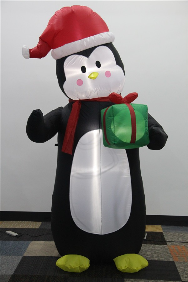 Inflatable christmas penguin with light and carry a gift box 2017