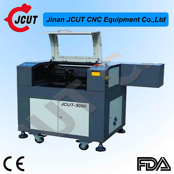 New type laser head cnc router and laser / metal laser engraving machine for sale