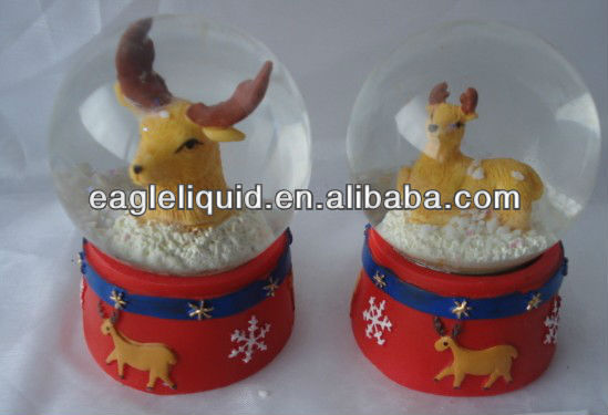 deer inside christmas electric snow globes