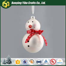 White glass Christmas snowman with red scarf ornament
