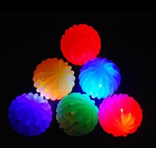 Hot selling honey comb flashing colorful rubber bounce ball with flashing led light