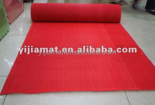 Rolls of red PVC cushion mat with foam back