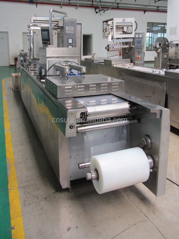 Automatic thermoforming tray vacuum packaging equipment