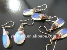trendy rain drop shaped moon gemstone with garnet stone on top held by high quality decor on fish hook earring