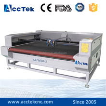 Double Heads Laser Cutting Machine for cloth/fabric/textile/leather/rubber/paper with auto feeding AKJ-1410