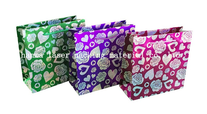 Valentine's Day holographic film coated paper bag wih PP handle in high quality
