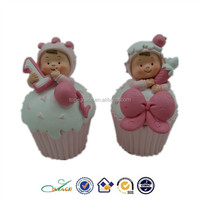 lovely baby on cake figurine polyresin