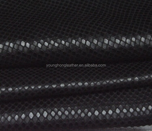 Black shiny cow grain leather with snake pattern for bags