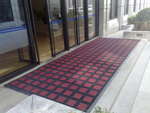 dust sand scraper entrance carpet mat to hotel bank entrance outdoor