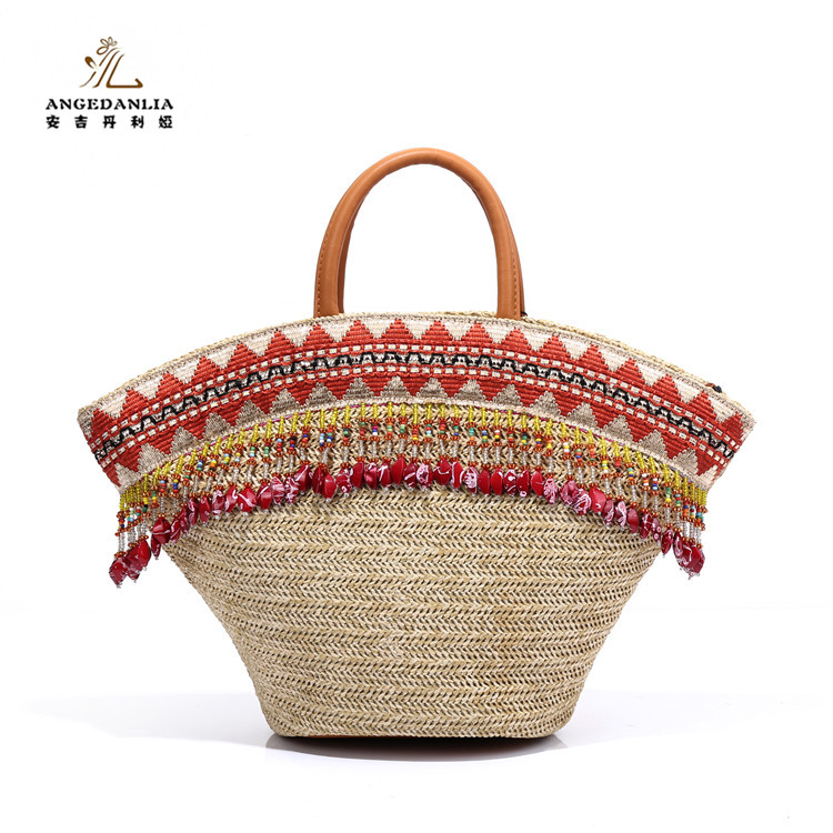 2017 New <strong>design</strong> ladies' fashion summer natural handmade seagrass beach straw bag tassel